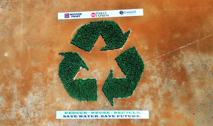Largest human recycling logo aerial view