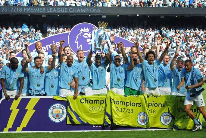 Man City celebrate their title win. Credit: Shutterstock