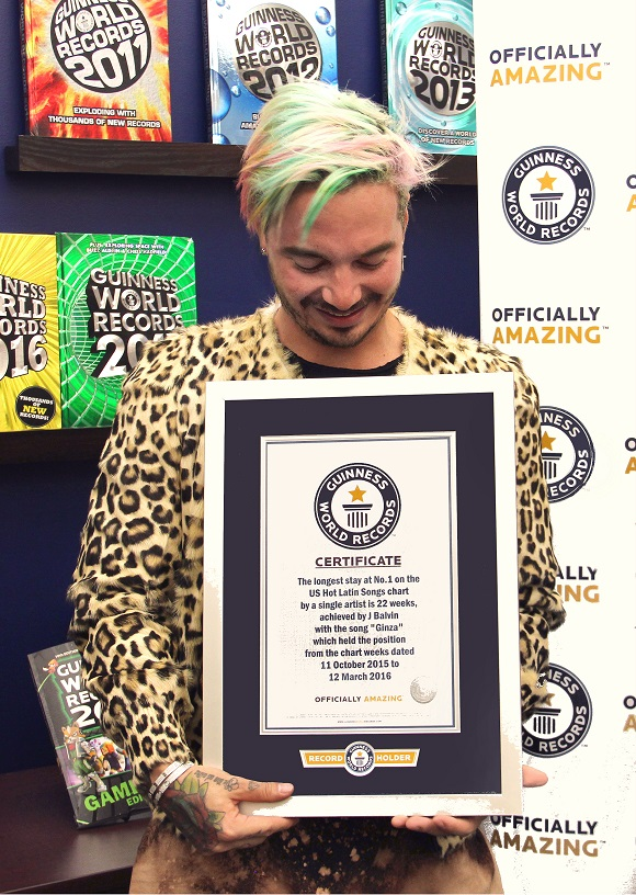 J Balvin with his certificate