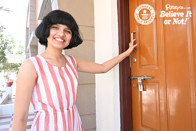 Nilanshi outside her front door with her new bobbed hairstyle