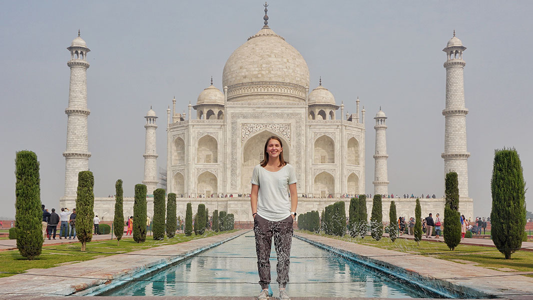 Fastest time to visit all sovereign countries by Taylor Demonbreun - seen her outside the Taj Mahal in India